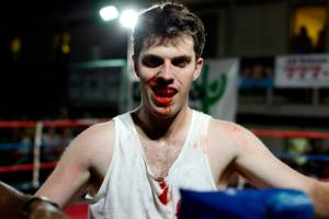 Andrew Kuchta of Sigma Chi & Lord's Boxing Gym smiling after a hard-fought win. ©Charlie Pearce